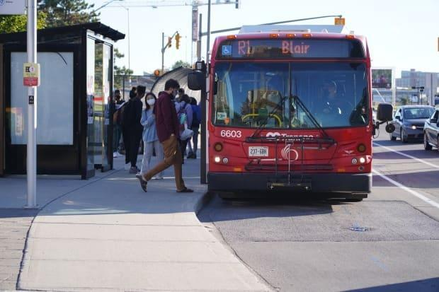 People board an OC Transpo bus on Sept. 20, 2021 during the fourth wave of the COVID-19 pandemic. Ontario's vaccine passport will not be required on public transit. (Francis Ferland/CBC - image credit)
