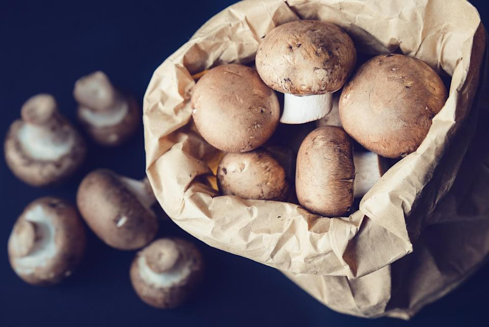 """<p>If you buy pre-packaged mushrooms wrapped in plastic, you can keep them in their original containers. If you buy mushrooms individually, prolong their shelf life by transferring them from a grocery produce bag into a paper bag when you get home. With those extra days, add some mushrooms into an egg scramble — mushrooms are one of those <a href=""""https://www.thedailymeal.com/eat/unexpected-ingredients-eggs?referrer=yahoo&category=beauty_food&include_utm=1&utm_medium=referral&utm_source=yahoo&utm_campaign=feed"""" rel=""""nofollow noopener"""" target=""""_blank"""" data-ylk=""""slk:unexpected ingredients that go great with eggs"""" class=""""link rapid-noclick-resp"""">unexpected ingredients that go great with eggs</a>.</p>"""