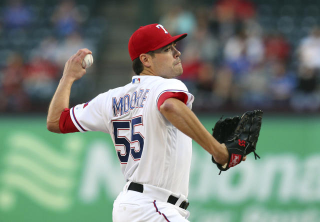 Texas Rangers starting pitcher Matt Moore works the first inning of a baseball game against the Oakland Athletics, Monday, April 23, 2018, in Arlington, Texas. (AP Photo/Richard W. Rodriguez)