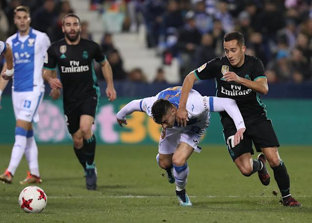 Soccer Football - Spanish King's Cup - Leganes vs Real Madrid - Quarter-Final - First Leg - Butarque Municipal Stadium, Leganes, Spain - January 18, 2018 Real Madrid's Lucas Vazquez in action with Leganes' Diego Rico REUTERS/Susana Vera