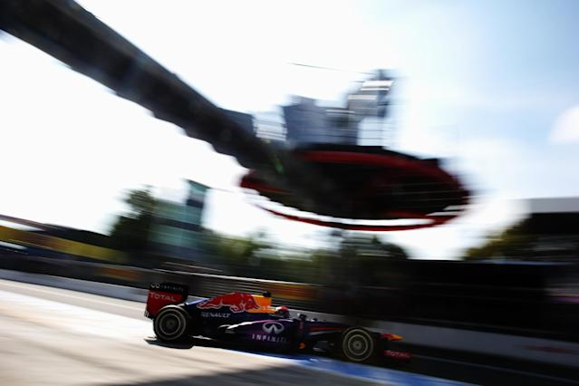 MONZA, ITALY - SEPTEMBER 07: Sebastian Vettel of Germany and Infiniti Red Bull Racing exits his garage to drive during qualifying for the Italian Formula One Grand Prix at Autodromo di Monza on September 7, 2013 in Monza, Italy. (Photo by Mark Thompson/Getty Images)
