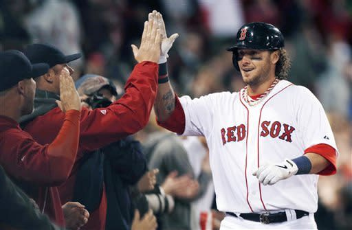 Boston Red Sox's Jarrod Saltalamacchia receives congratulations for his solo home run in the sixth inning of a baseball game against the Baltimore Orioles in Boston, Wednesday, April 10, 2013. (AP Photo/Michael Dwyer)