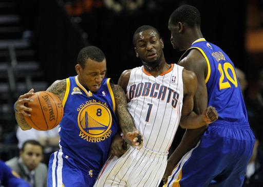 CHARLOTTE, NC - JANUARY 14: Kemba Walker #1 of the Charlotte Bobcats is stuck between teammates Monta Ellis #8 and Ekpe Udoh #20 of the Golden State Warriors during their game at Time Warner Cable Arena on January 14, 2012 in Charlotte, North Carolina. (Photo by Streeter Lecka/Getty Images)