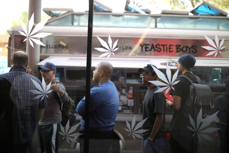 FILE PHOTO: Customers queue for recreational marijuana outside the MedMen store in West Hollywood
