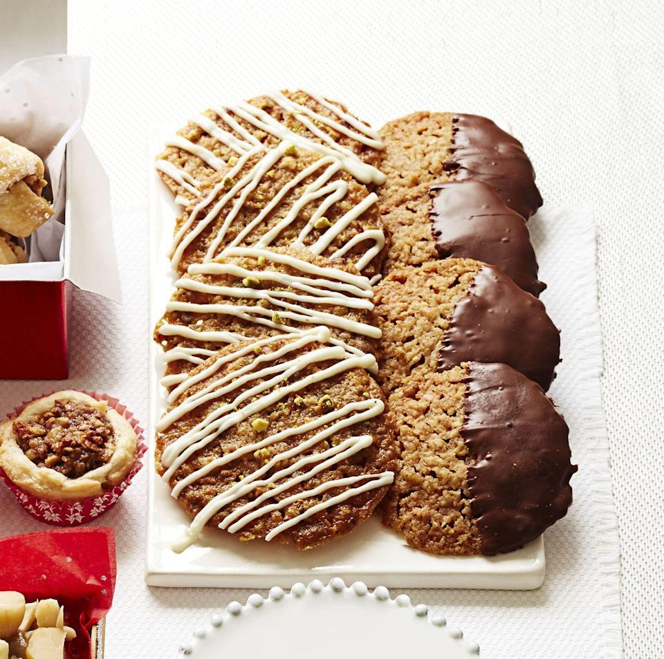 """<p>Ground cashews lend a rich, nutty bite to these hearty oat-coconut cookies.</p><p><em><a href=""""https://www.goodhousekeeping.com/food-recipes/a14592/chocolate-coconut-lace-cookies-recipe-ghk1213/"""" rel=""""nofollow noopener"""" target=""""_blank"""" data-ylk=""""slk:Get the recipe for Chocolate-Coconut Lace Cookies »"""" class=""""link rapid-noclick-resp"""">Get the recipe for Chocolate-Coconut Lace Cookies »</a></em></p>"""