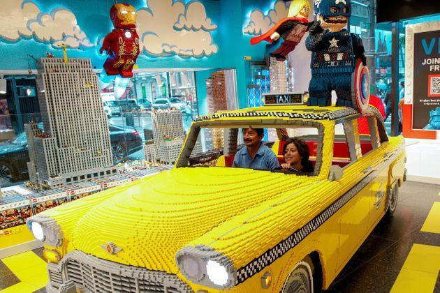 Customers pose for a photo in a Lego Taxi in the 5th Avenue Lego store in New York City, U.S., September 28, 2021.  REUTERS/Brendan McDermid (Photo: Brendan McDermid via Reuters)