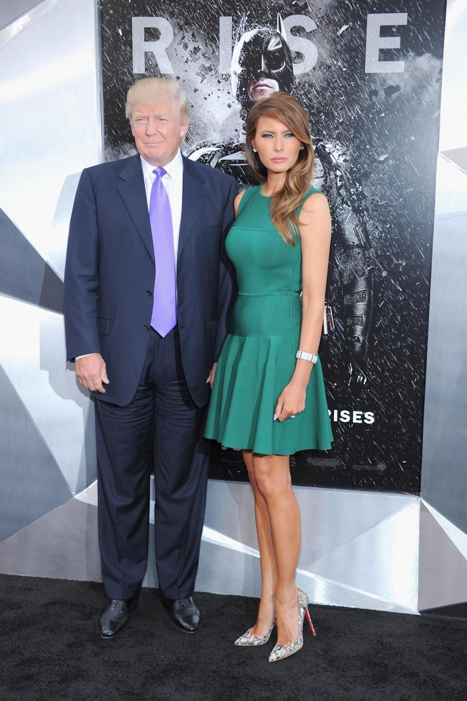 <p>For the premiere of <i>The Dark Knight Rises</i>, Melania donned a fitted green minidress and yet another pair of Louboutins. <i>[Photo: Getty]</i> </p>