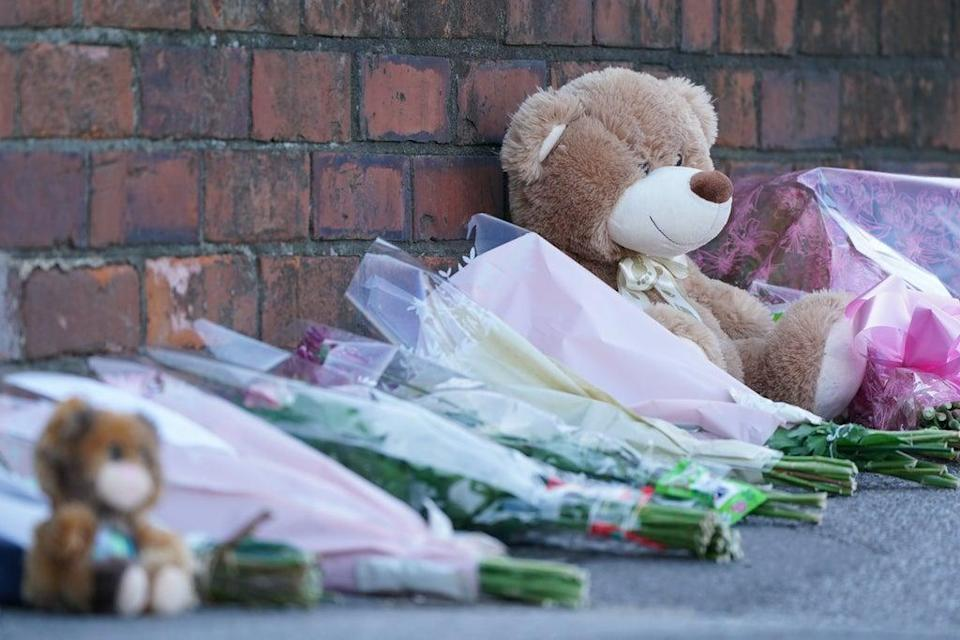 Floral tributes and teddy bears left at the scene in High Holme Road, Louth (Joe Giddens/PA) (PA Wire)