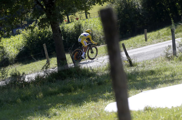 France's Julian Alaphilippe wearing the overall leader's yellow jersey rides during the thirteenth stage of the Tour de France cycling race, an individual time trial over 27.2 kilometers (16.9 miles) with start and finish in Pau, France, Friday, July 19, 2019. (AP Photo/Thibault Camus)