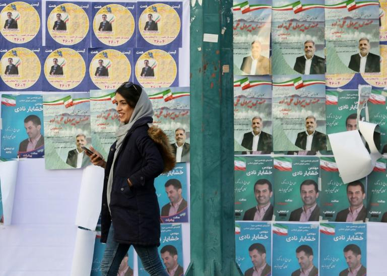 Commentators expect disillusionment among voters in sanctions-hit Iran to result in a low turnout in Friday's parliamentary election despite government appeals for a show of unity (AFP Photo/ATTA KENARE)