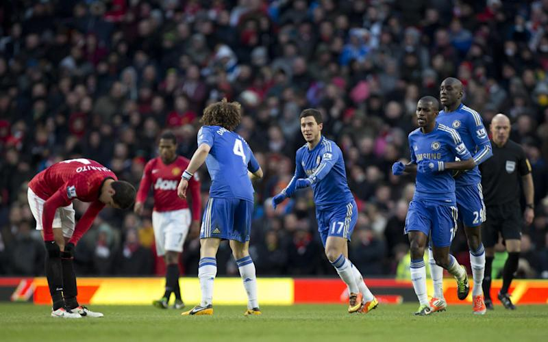 Chelsea's Eden Hazard, centre, celebrates with teammates after scoring against Manchester United during their English FA Cup quarterfinal soccer match at Old Trafford Stadium, Manchester, England, Sunday March 10, 2013. (AP Photo/Jon Super)