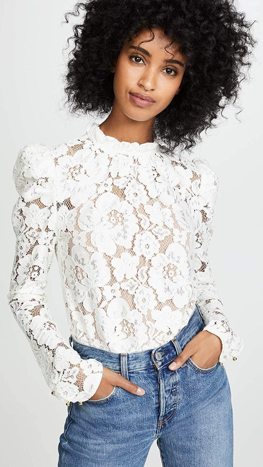 <p>Turn heads in this stunning <span>Wayf Emma Puff-Sleeved Lace Top</span> ($89).</p>