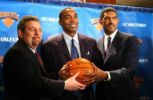 Isiah Thomas (center) holds a ball with owner James Dolan (left) and president of sports operations Steve Mills after being named the Knicks' new president of basketball operations on Dec. 22, 2003. (AP)