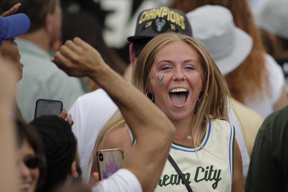 A fan cheers during a parade celebrating the Milwaukee Bucks' NBA Championship Thursday, July 22, 2021, in Milwaukee. (AP Photo/Aaron Gash)