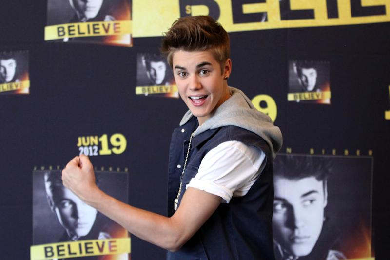 Pop star Justin Bieber poses for photos prior to a press conference at a hotel in Mexico City, Monday, June 11, 2012. Bieber will perform in a free open-air concert tonight at the Mexico City's main historic plaza, the Zocalo. (AP Photo/Alexandre Meneghini)