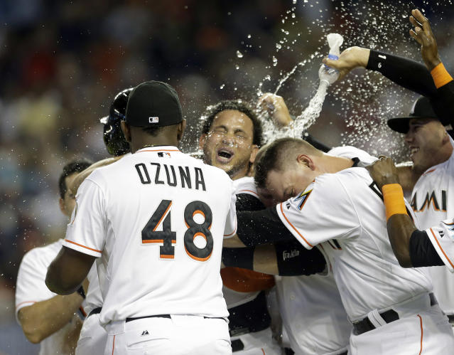 Miami Marlins' Henderson Alvarez, center, celebrates with teammates after pitching a no-hitter against the Detroit Tigers after an interleague baseball game, Sunday, Sept. 29, 2013, in Miami. The Marlins won 1-0. (AP Photo/Alan Diaz)