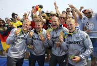 <p>Gold medalists Max Rendschmidt, Tom Liebscher, Max Hoff, and Marcus Gross of Germany pose with their medals for the men's kayak four 1000m race at Lagoa Stadium in Rio on August 20, 2016. (REUTERS/Murad Sezer) </p>