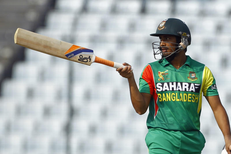 Bangladesh's Anamul Haque acknowledges the crowed after scoring fifty runs during the Asia Cup one-day international cricket tournament against Pakistan in Dhaka, Bangladesh, Tuesday, March 4, 2014. (AP Photo/A.M. Ahad)