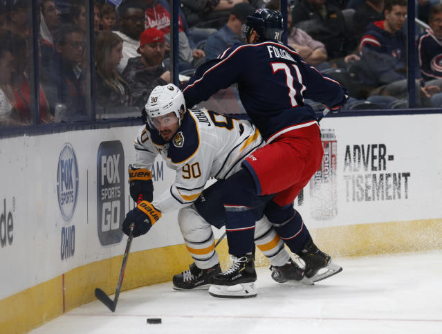 Buffalo Sabres forward Marcus Johansson, left, of Sweden, works for the puck against Columbus Blue Jackets forward Nick Foligno during the second period of an NHL hockey game in Columbus, Ohio, Monday, Oct. 7, 2019. (AP Photo/Paul Vernon)