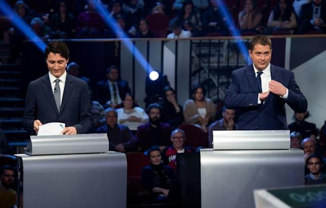 The campaign between Justin Trudeau (L) and Andrew Scheer included attack ads with false accusations (AFP Photo/Adrian Wyld)