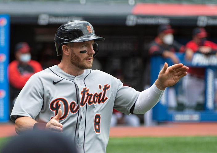 Detroit Tigers' Robbie Grossman celebrates after scoring on an RBI single by Jeimer Candelario during the first inning of a MLB game in Cleveland, Sunday, April 11, 2021.