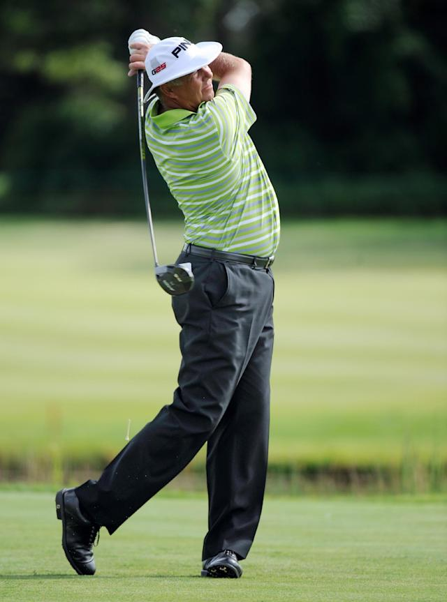 Kirk Triplett tees off on the 18th hole during the final round of the 3M Players Championship golf tournament at TPC Twin Cities golf course Sunday, Aug. 4, 2013, in Blaine, Minn. (AP Photo/Craig Lassig)