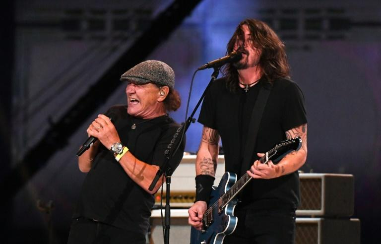 Brian Johnson from AC/DC performs with Dave Grohl (R) of the Foo Fighters during the taping of the 'Vax Live' fundraising concert