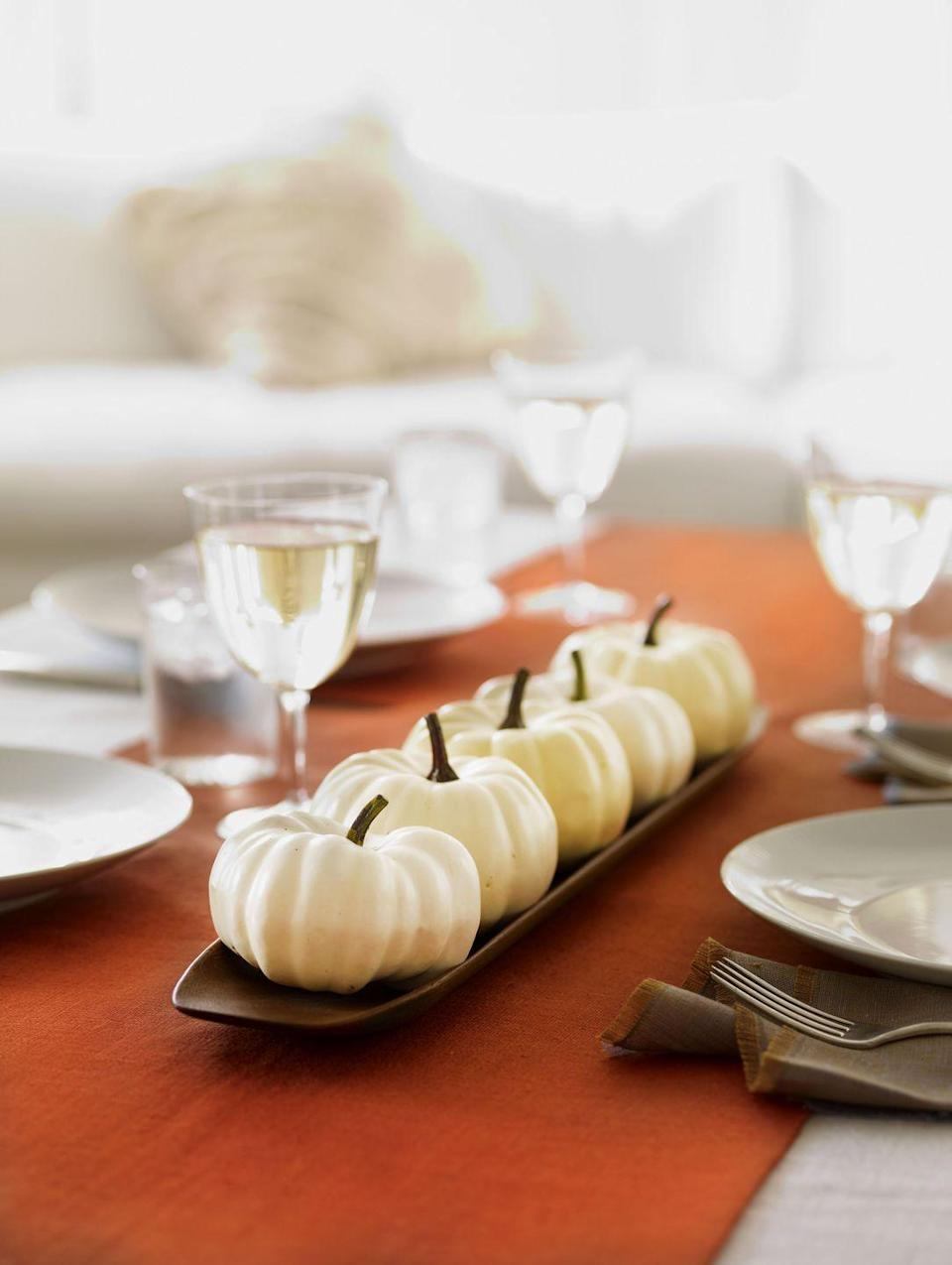 <p>Love nothing more than a minimalist look? Corral a selection of small white pumpkins for an adorable Thanksgiving table setup. </p>
