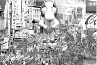 <p>A colossal Snoopy balloon travels through Times Square during the 43rd Annual Macy's Thanksgiving Day Parade.</p>
