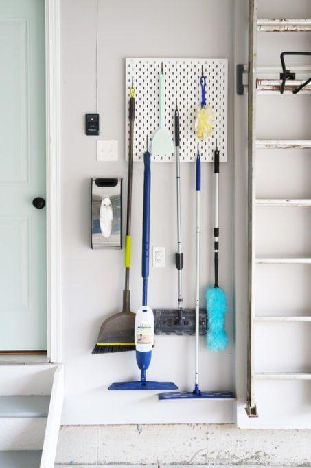 """<p>Because they're so easily adjustable, pegboards are an ideal choice for hanging your cleaning implements.</p><p><strong>Get the tutorial at <a href=""""https://justagirlandherblog.com/planning-a-garage-organization-project/"""" rel=""""nofollow noopener"""" target=""""_blank"""" data-ylk=""""slk:Just a Girl and Her Blog"""" class=""""link rapid-noclick-resp"""">Just a Girl and Her Blog</a>.</strong></p><p><a class=""""link rapid-noclick-resp"""" href=""""https://www.amazon.com/Pegboard-Combination-Punching-Bathroom-Organizer/dp/B08XKG5S3P/ref=sr_1_2_sspa?tag=syn-yahoo-20&ascsubtag=%5Bartid%7C10050.g.36449426%5Bsrc%7Cyahoo-us"""" rel=""""nofollow noopener"""" target=""""_blank"""" data-ylk=""""slk:SHOP PEGBOARDS"""">SHOP PEGBOARDS</a></p><p><strong>RELATED: </strong><a href=""""https://www.countryliving.com/home-maintenance/cleaning/a34702591/how-to-clean-hardwood-floors/"""" rel=""""nofollow noopener"""" target=""""_blank"""" data-ylk=""""slk:How to Clean Hardwood Floors and Have Them Looking Like New"""" class=""""link rapid-noclick-resp""""><strong>How to Clean Hardwood Floors and Have Them Looking Like New</strong></a></p>"""