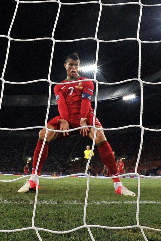 TOPSHOTS  Portuguese forward Cristiano Ronaldo celebrates after scoring during the Euro 2012 football championships match Portugal vs. Netherlands on June 17, 2012 at the Metalist stadium in Kharkiv.    AFP PHOTO / FILIPPO MONTEFORTEFILIPPO MONTEFORTE/AFP/GettyImages