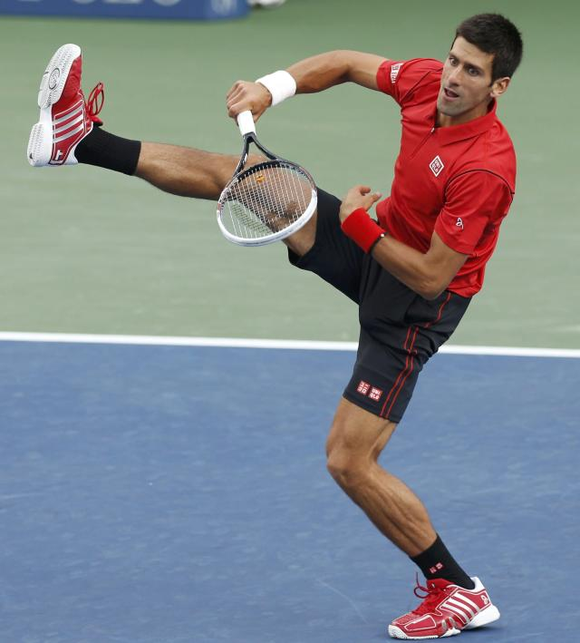 Novak Djokovic of Serbia serves to Rafael Nadal of Spain during their men's final match at the U.S. Open tennis championships in New York, September 9, 2013. REUTERS/Adam Hunger (UNITED STATES - Tags: SPORT TENNIS)