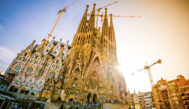 The famous church designed by the spanish architect Antoni Gaudi, taken in backlight with tilt shift effect and toning.