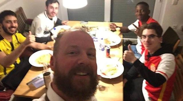 """<p>AS Monaco and Borussia Dortmund fans came together on social media after their latest Champions League game was rescheduled after <a href=""""https://www.si.com/planet-futbol/2017/04/11/borussia-dortmund-champions-league-bus-explosion-update"""" rel=""""nofollow noopener"""" target=""""_blank"""" data-ylk=""""slk:three explosions went off"""" class=""""link rapid-noclick-resp"""">three explosions went off</a> in the vicinity of Borussia Dortmund's team bus.</p><p>Monaco fans were offered beds and a place to stay by Dortmund fans, if they plan on staying for the game. #BedForAwayFans was used for supporters to locate a place to stay. </p><p>Many answered the call.</p><p>Marc Bartra was taken to the hospital after an explosion went off near the team bus and on the way to Signal Iduna Parl stadium. Bartra sustained cuts in his arm from the broken glass, according to Marca. The team announced he will have wrist surgery. The club said in a statement that players were safe and that there was no danger around or inside Dortmund's stadium.</p><p>The game is now set for Wednesday at 8:45 p.m. local time.</p>"""