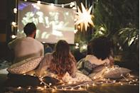"""<p>All you need is a project, a blank wall or sheet, and your favorite movie for a cinema experience just like the movies. Don't forget the popcorn!</p><p><a class=""""link rapid-noclick-resp"""" href=""""https://www.amazon.com/QKK-Projector-Brightness-Compatible-Smartphone/dp/B07MWSKNKZ/?tag=syn-yahoo-20&ascsubtag=%5Bartid%7C10050.g.30445302%5Bsrc%7Cyahoo-us"""" rel=""""nofollow noopener"""" target=""""_blank"""" data-ylk=""""slk:SHOP PROJECTORS"""">SHOP PROJECTORS</a></p>"""