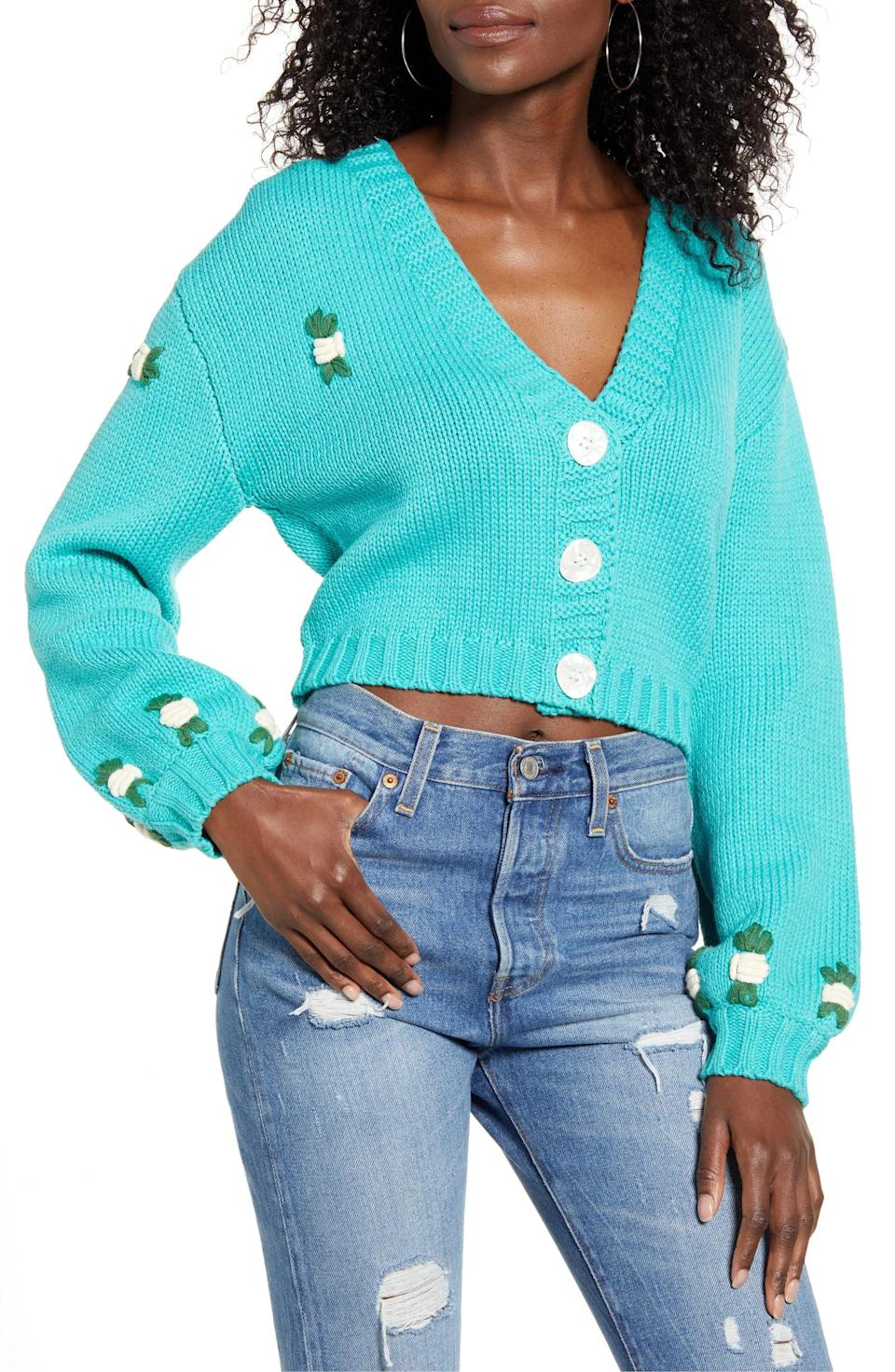 <p>This colorful <span>Tegan Floral Crop Cardigan Sweater</span> ($108) provides ample warmth while looking stylish for date night.</p>