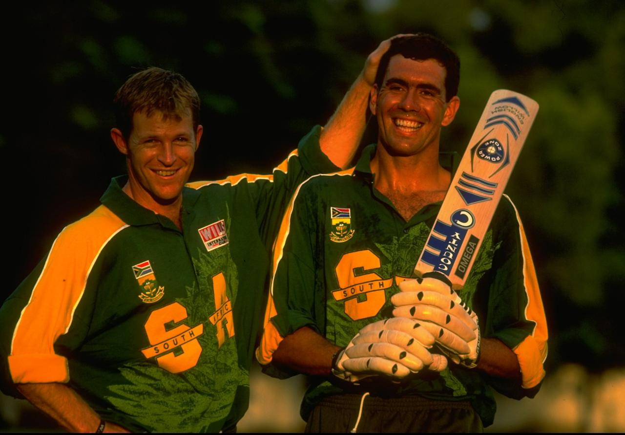 1998:  Jonty Rhodes and Hansie Cronje of South Africa in action during a Pepsi Commission at the Wills International Cup played in Dhaka, Bangladesh.  \ Mandatory Credit: Clive Mason /Allsport