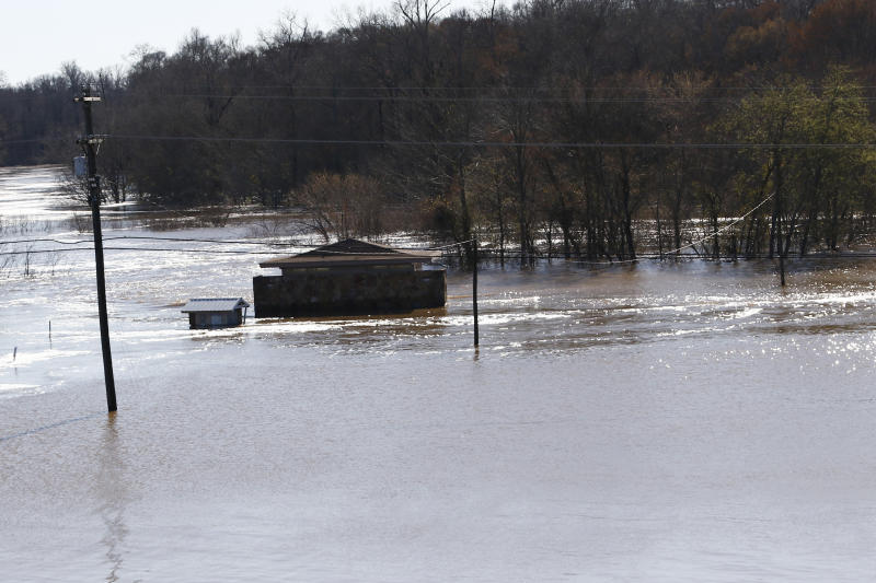 The restrooms on the Madison County side of the Ross Barnett Reservoir Spillway Park are about the only structure still visible as floodwaters have covered both sides of the popular fishing and boat landing in central Mississippi, Friday, Feb. 14, 2020. The gates to the Ross Barnett Reservoir Spillway Park are chained closed as floodwaters have covered both sides of the popular fishing and boat landing in Rankin County, Miss., Friday, Feb. 14, 2020. On Sunday, the river is expected to crest at 38 feet. Only twice before has the Pearl River surpassed 38 feet — during the historic floods of 1979 and 1983. (AP Photo/Rogelio V. Solis)