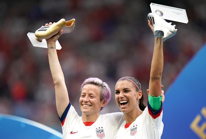 USA's Megan Rapinoe (left) and Alex Morgan with the adidas Golden Boot and adidas Silver Boot respectively after the final whistle USA v Netherlands - FIFA Women's World Cup 2019 - Final - Stade de Lyon 07-07-2019 . (Photo by John Walton/EMPICS/PA Images via Getty Images)