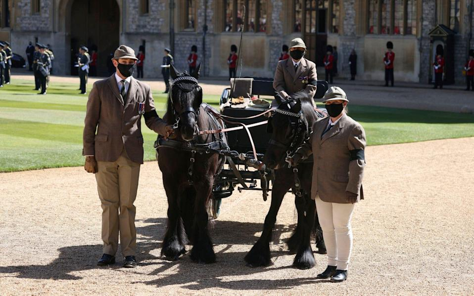 Fell ponies Balmoral Nevis and Notlaw Storm, and the Duke of Edinburgh's driving carriage, pause, in the Quadrangle - Pool via AP