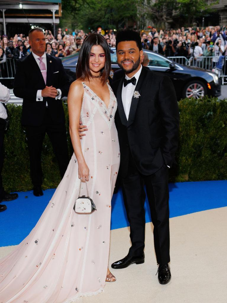 Selena Gomez and The Weeknd made their debut as a couple at the Met gala. (Photo: Jackson Lee/FilmMagic)
