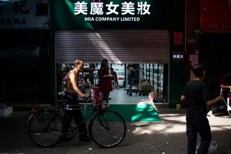Sheung Shui boasts dozens of pharmacies and cosmetic stores that are hugely popular with mainland merchants who snap up goods in Hong Kong -- where there is no sales tax -- and resell them across the border (AFP Photo/Philip FONG)