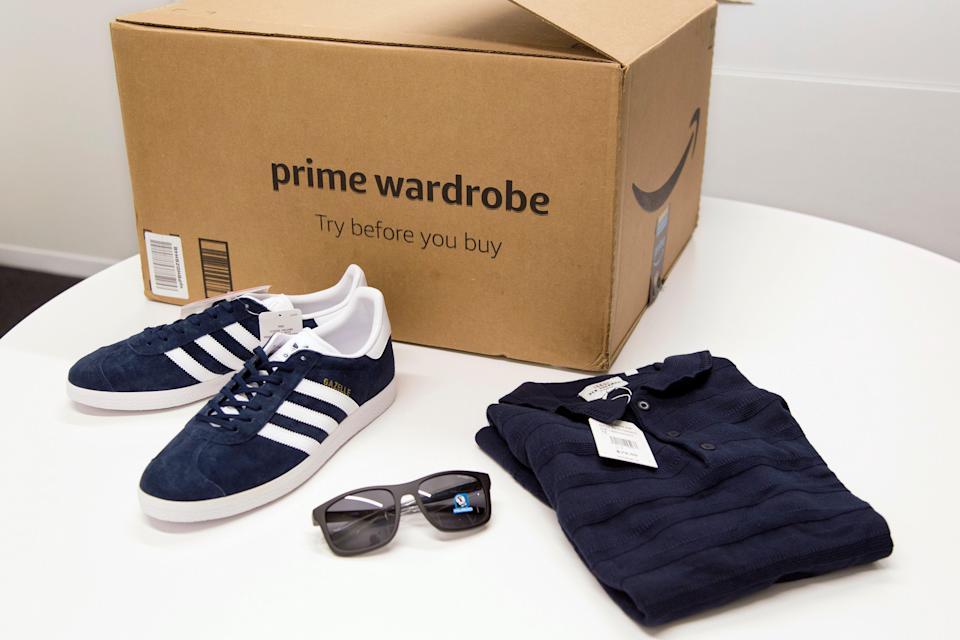 FILE - In this April 12, 2018 file photo, items ordered through Prime Wardrobe are displayed in New York. Amazon hopes to turn your home into a fitting room, after shipping you a box of fashions to try on before paying. It sounds a lot like Stitch Fix, Trunk Club or other services that send clothing in a box. But there are differences: There are no stylists with Prime Wardrobe, so you'll have to pick out your own shirts or skirts.  (AP Photo/Mark Lennihan, File)