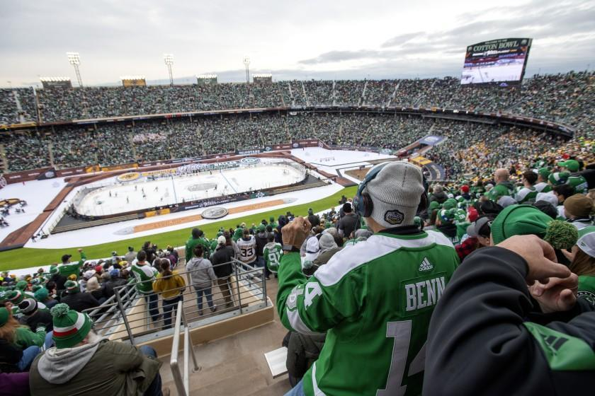 Dallas Stars fans watch play during the second period of the NHL Winter Classic hockey game between the Dallas Stars and the Nashville Predators at the Cotton Bowl, Wednesday, Jan. 1, 2020, in Dallas. Dallas won 4-2. (AP Photo/Jeffrey McWhorter)
