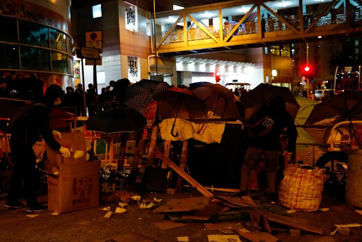 Protesters set up a barrier to block the road outside of a newly built residential building in Hong Kong that authorities planned to use as a quarantine facility. (Reuters)