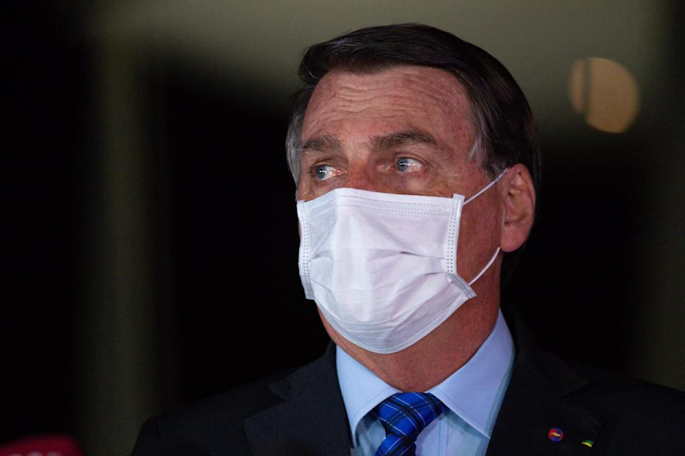 BRASILIA, BRAZIL - AUGUST 12: Jair Bolsonaro President of Brazil makes apronouncement reaffirming his commitment to the government spending ceiling amidst the coronavirus(COVID-19) pandemic at the Alvorada Palaceon August 12, 2020 in Brasilia. President of the Senate Davi Alcolumbre, Rodrigo Maia, president of Brazil's Lower House, Economy Minister Paulo Guedes and parliamentarians and ministers accompanied the president. Brazil has over 3.164,000 confirmed positive cases of Coronavirus and has over 104,201 deaths. (Photo by Andressa Anholete/Getty Images)