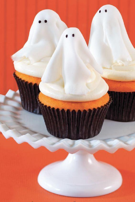 """<p>These sweet treats are deliciously spooky — and easy to make! Just use store-bought cake mix and whisk together a quick, creamy marshmallow frosting.</p><p><em><a href=""""https://www.womansday.com/food-recipes/food-drinks/a28834832/ghost-cupcakes-recipe/"""" rel=""""nofollow noopener"""" target=""""_blank"""" data-ylk=""""slk:Get the recipe from Woman's Day »"""" class=""""link rapid-noclick-resp"""">Get the recipe from Woman's Day »</a></em></p>"""