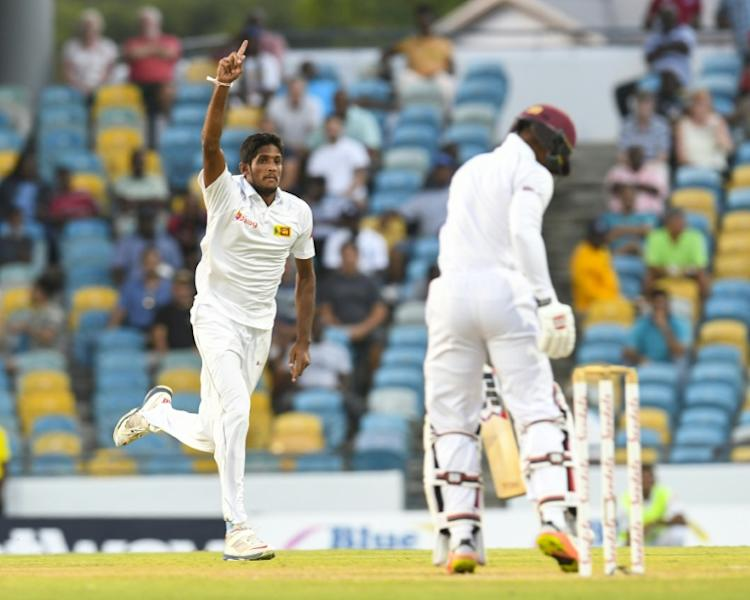Kasun Rajitha (L) of Sri Lanka celebrates the dismissal of Shai Hope of West Indies on Day 1 of their 3rd Test, at Kensington Oval in Bridgetown, Barbados, on June 23, 2018