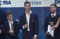 Juventus' Cristiano Ronaldo smiles after winning the trophy for best Italian Serie A player, during the Gran Gala' soccer awards ceremony, in Milan, Italy, Monday, Dec. 2, 2019. (AP Photo/Antonio Calanni)