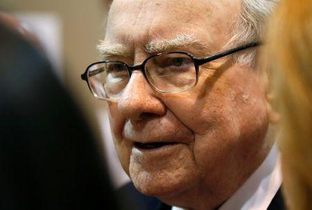Berkshire Hathaway chairman and CEO Warren Buffett talks with a reporter before the Berkshire's annual meeting in Omaha